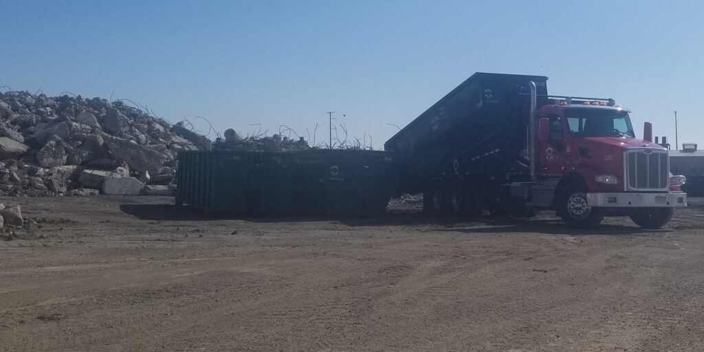 Customer dumping used aggregate rubble at Colorado Aggregate Recycling's yard.